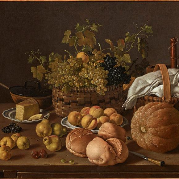 Bodegón con enfriador, panes, queso y frutas