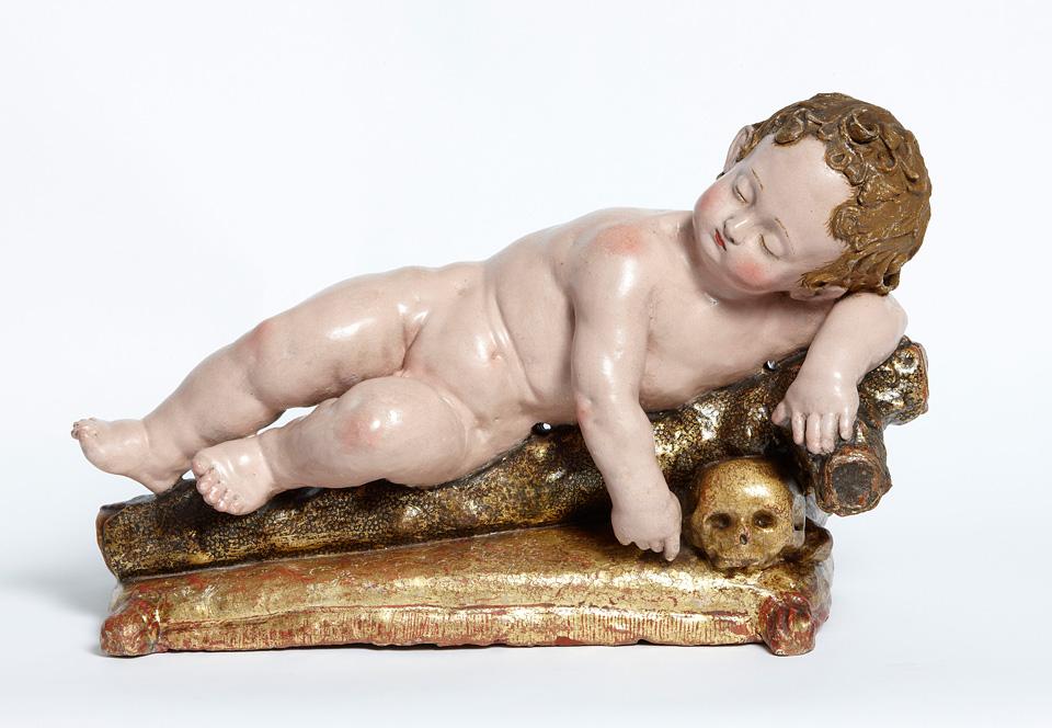 Niño Jesús dormido sobre los símbolos de la Pasión